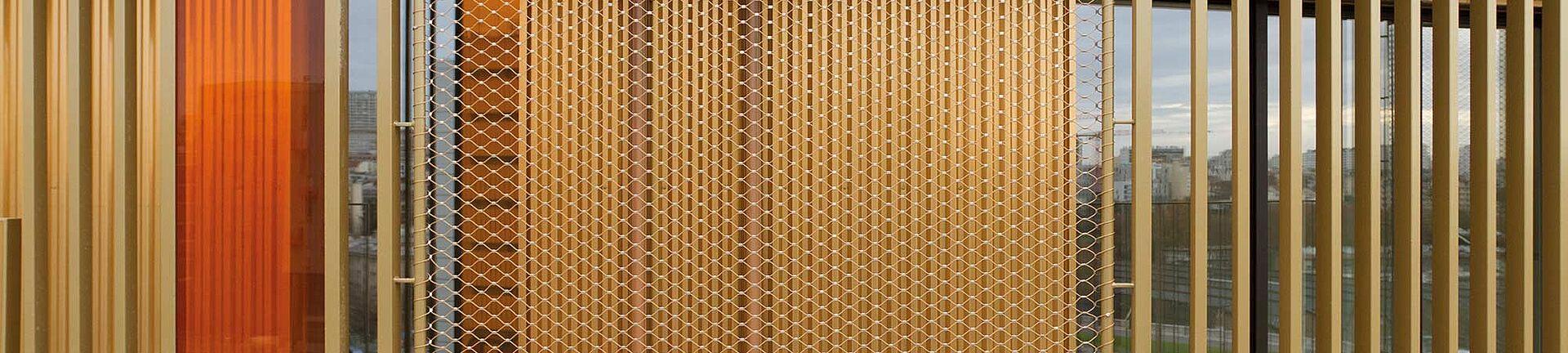 Fassade goldenes Netz paris X-TEND Colours